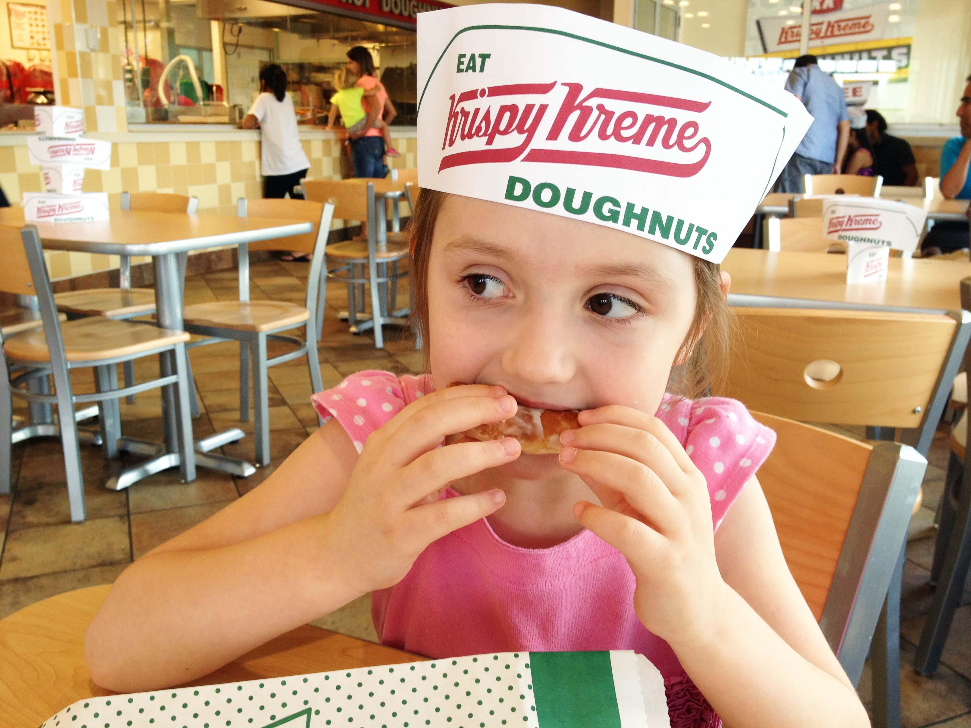 Fluffy eats a Krispy Kreme