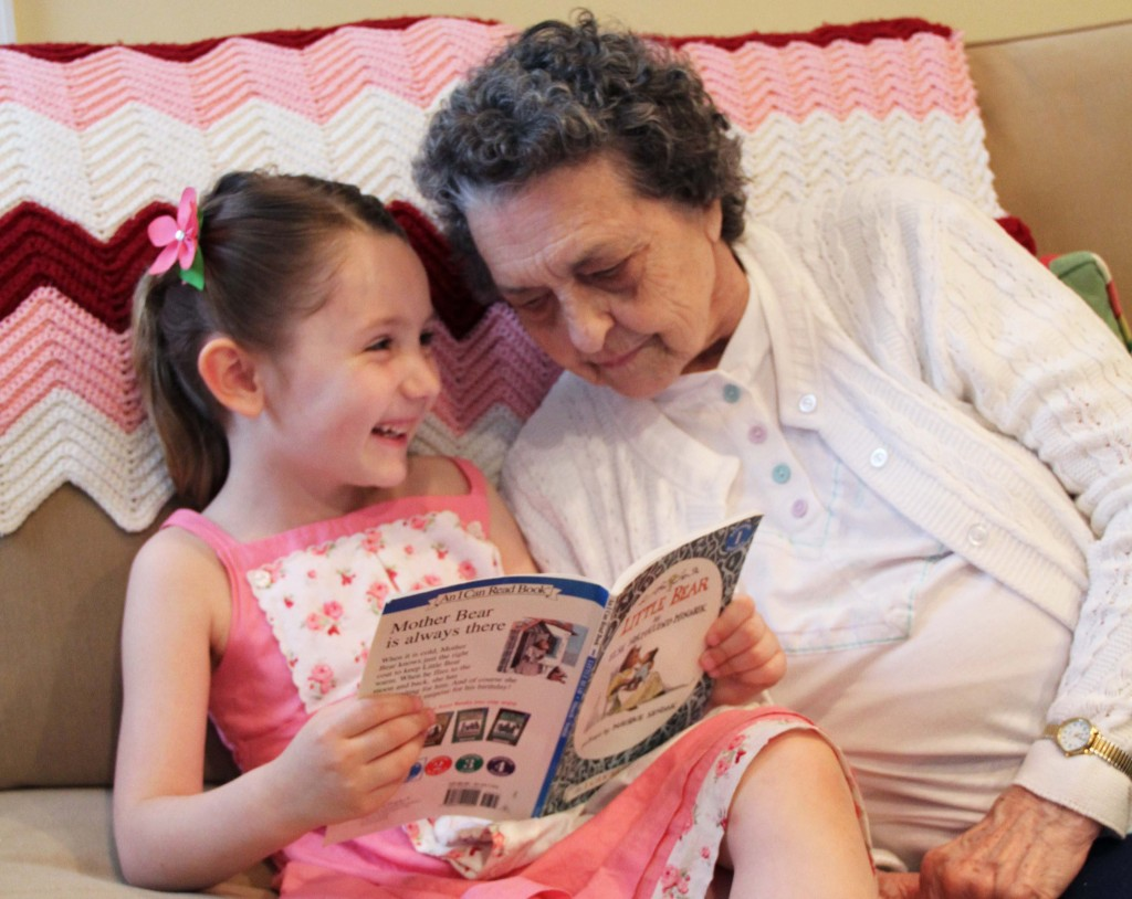 Fluffy reading a book to Grandma Dorothy