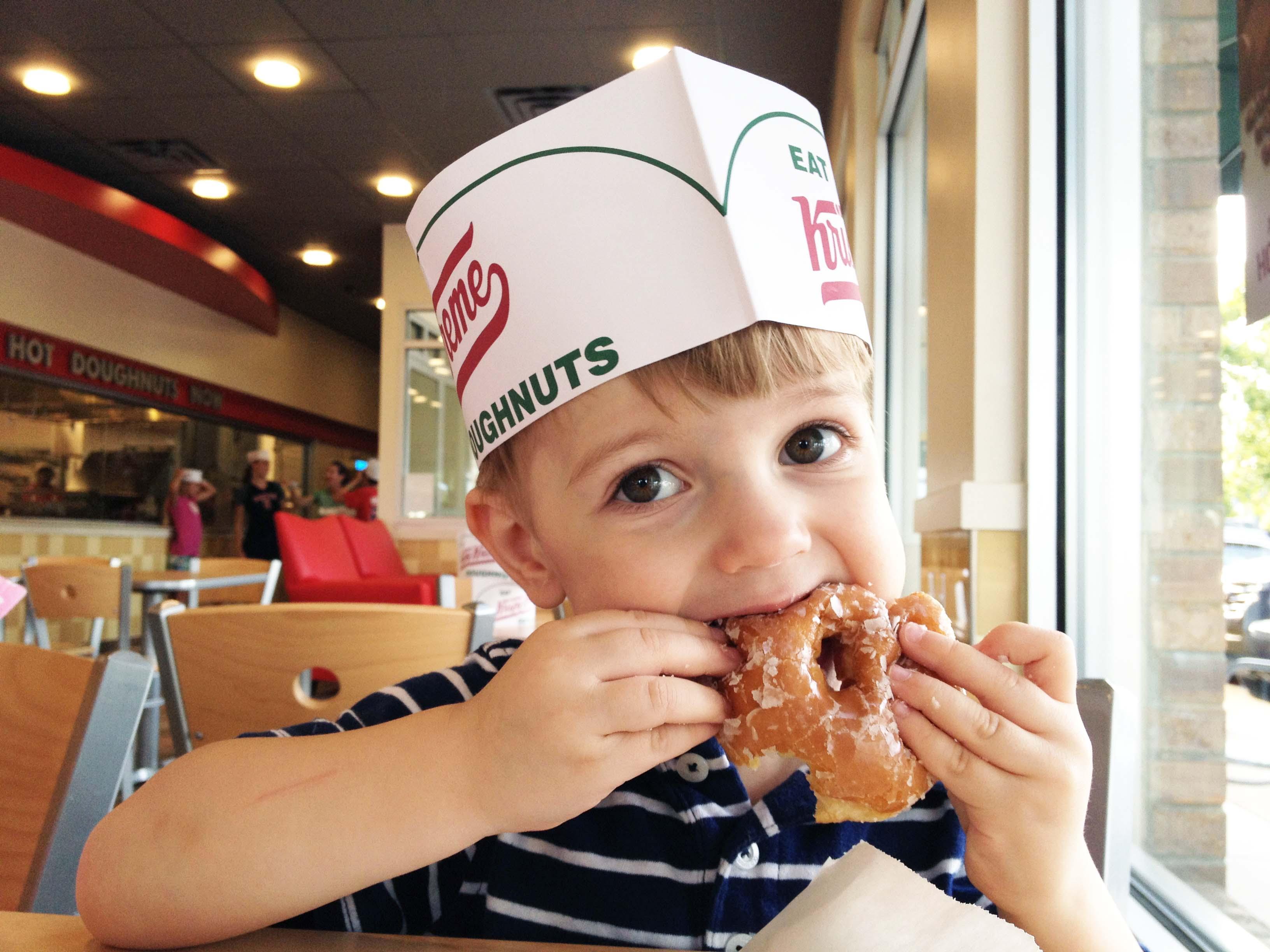 Salty eats a Krispy Kreme