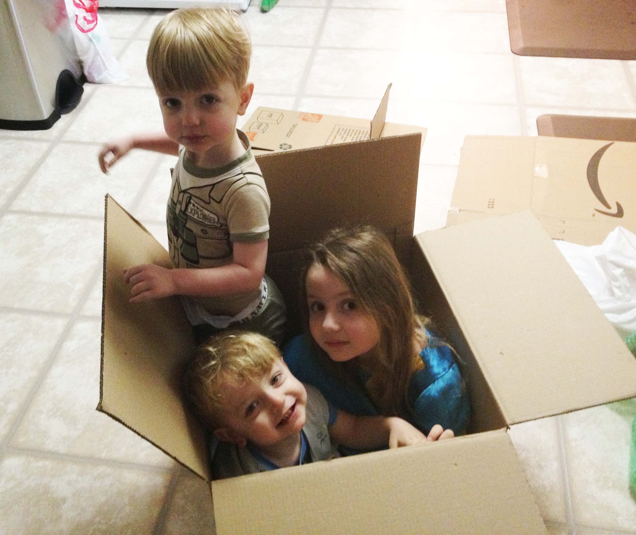 kids in a packing box