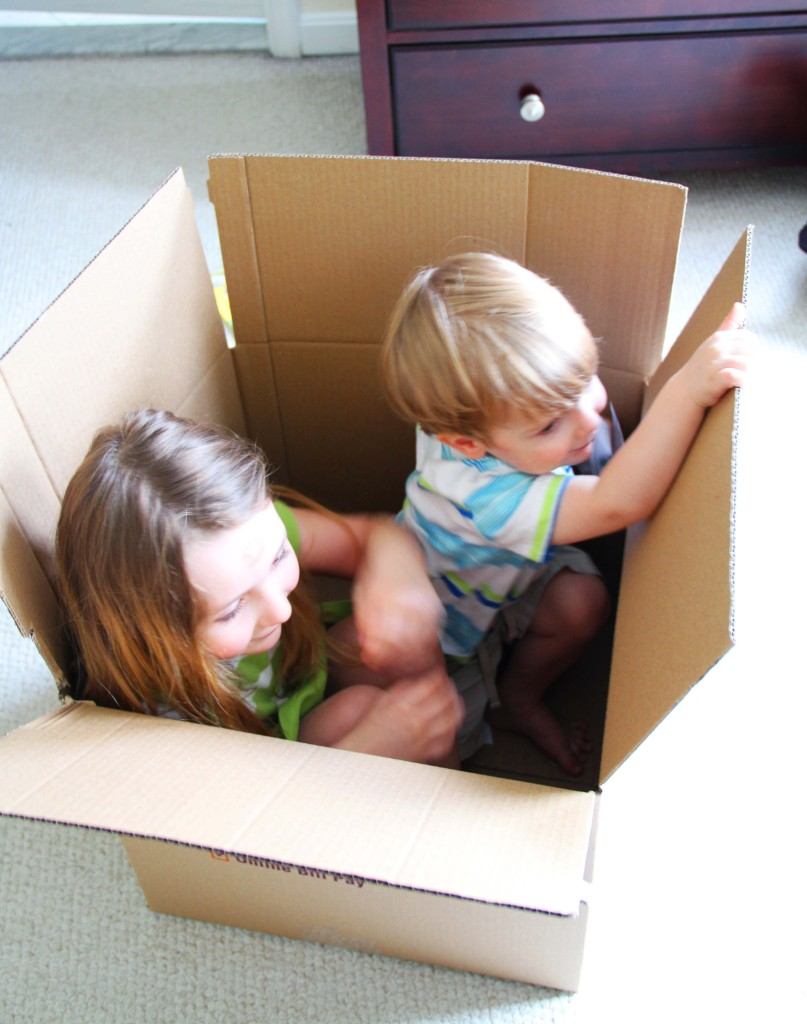 kids playing in packing boxes