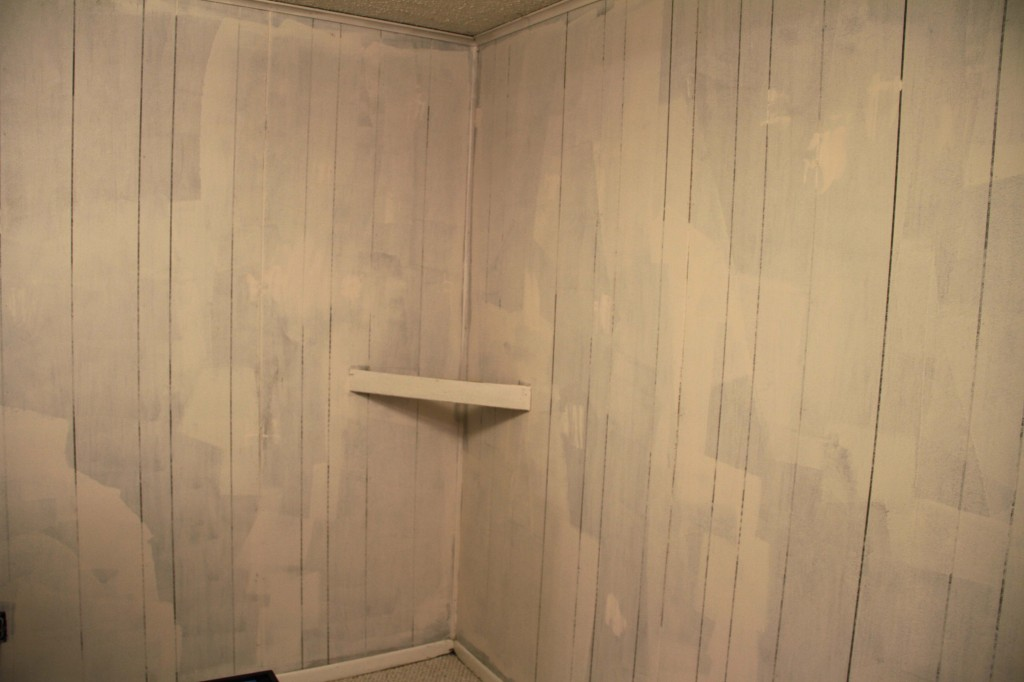 shellac primer rolled onto paneling - Rental Improvement: Painting Faux Wood Paneling Put That On Your