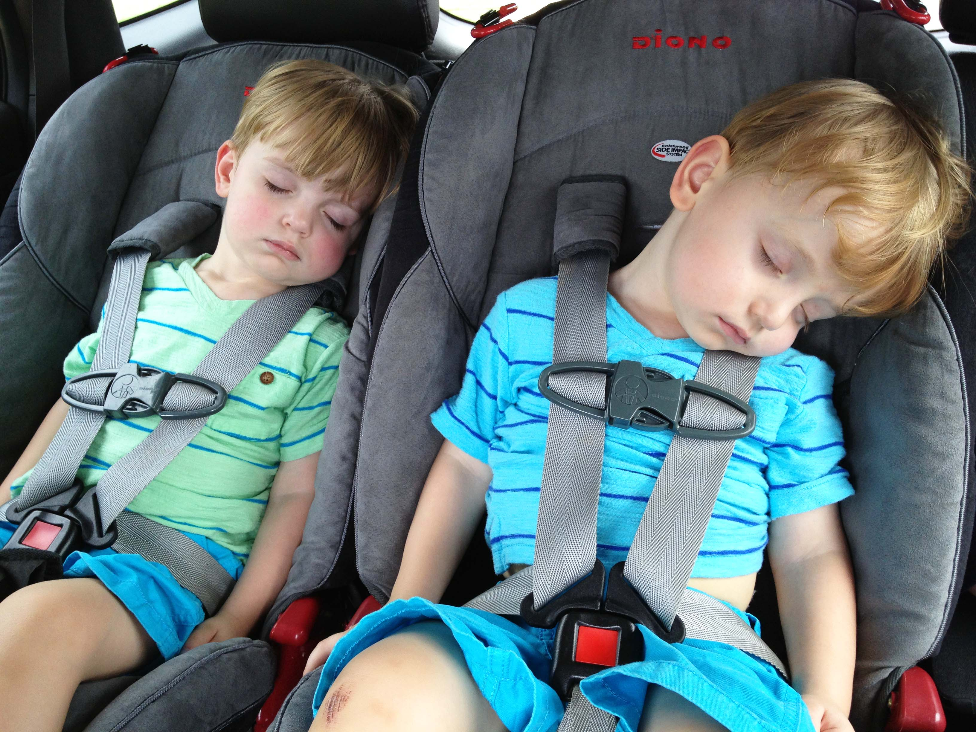 sleeping twins in clean car seats